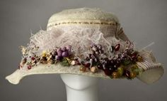 1900s cream lace hat with fruit decoration.