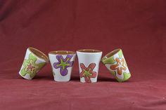 A lovely set of tumblers for shots and Tsipouro (a local alcoholic brew from Greece) adding colour to your party. This object is made of low-temperature clay, the technique Sgraffito and many different dots colors. The object is suitable for food, microwave and dishwasher.  Weight= 400 gram Height= 7cm