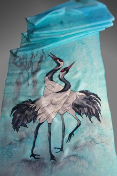 Hand painted silk scarf with a pair of cranes. Turquoise silk scarf. Bird silk scarf. Made to order. It will take me about 10 days to make the scarf for you. 18x69inches (175 X45 cm) It is made of 100% pure silk in a non-smoking environment. I used professional dyes and steam to fix the colors. So this scarf will serve you many years without fading. The scarf is as light as a feather and drapes beautifully around your neck and shoulders. You can wear it as a wrap with your evening dress a...