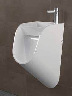 "Tandem is a multifunctional bathroom sink-cum-urinal designed by Kaspars Jursons of Stand. In designer's words, ""A sink and urinal are combined into a sing"