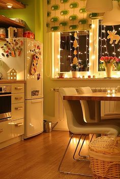 New York apartment minus the curtains! what a cute kitchen with the lights..makes everything look so homey.