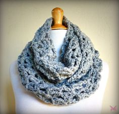 A chunky, versatile infinity scarf/cowl, created with a silky-soft yarn. Wraps up snugly around the neck (able to be wrapped around twice), or can be