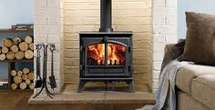 Image result for wood burning stoves fire surrounds