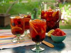 California Rose Punch from Bobby Flay:  1 bottle California rose wine, chilled , 2 cups sparkling lemonade, chilled , 1/2 cup blackberry liqueur, chilled , 1 cup blackberries , 1 cup raspberries , 6 nectarines, sliced , 1 lemon, cut into wedges  , 1 small orange, cut into wedges
