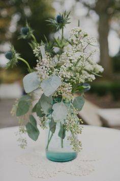 Rustic Wildflower #Centerpieces in Vintage Glass I Birchtree Catering I #Rustic #wedding