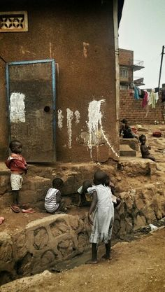 Street kids playing in Katwe, Kampala Uganda Africa Photography