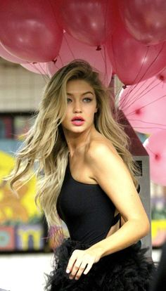 Gigi Hadid ♥ pink balloon shot - magazine cover - long blonde, wavy hair, celebrity street style