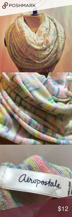 Aeropostle Neon Infinity Scarf White Soft Pastel Lovely soft unused Aeropostale scarf.  Infinity.  Neon colors but still seems pastel over all.  No damage or flaws that I can find.  Retails $29.50 Aeropostale Accessories Scarves & Wraps