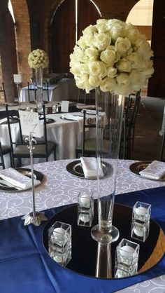 Raw set-up, royal blue, candles, taffeta runner, table number silver stand, glads vase. A GHINOMAE event. Info@ghinomae.co.za