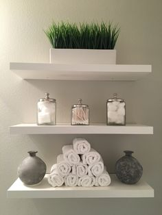 Bathroom shelves modern clean white and grey added shelves green transitional new construction socal home decorative contemporary decor Toilet Shelves, Bathroom Shelves Over Toilet, Bathroom Shelf Decor, Floating Shelves Bathroom, Bathroom Ideas, Bathroom Storage, Shelf Desk, Bathroom Wall, Floating Toilet