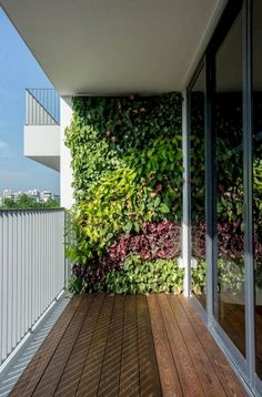 Stunning Vertical Garden for Wall Decor Ideas Do you have a blank wall? do you want to decorate it? the best way to that is to create a vertical garden wall inside your home. A vertical garden wall, also called… Continue Reading → Small Balcony Design, Small Balcony Garden, Vertical Garden Design, Small Balcony Decor, Balcony Ideas, Vertical Gardens, Indoor Balcony, Terrace Ideas, Balcony Plants