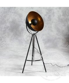 Tripod spotlight floor lamp A beautiful statement piece that combined subtlety with original design. This tripod floor lamp is as effective as it is original thanks to a homely yet worn industrial feel which is leading modern interior design trends.