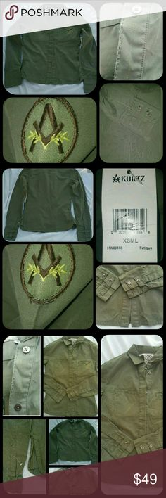 A Kurtz Military Shirt Jacket Vtg Grunge Aesthetic Bnwt  A Kurtz Military Shirt Jacket..a bit heavier than a regular shirt but not quite so heavy to be a jacket IMO.  SZ XS MSRP $92 COLOR.ON TAG IS FATIGUE  *PLS NOTE I TOOK PICS W/&W/OUT FLASH SO THE SHADE VARIES DEPENDING ON LIGHTING, HARD TO SAY WHAT THE BEST REP WOULD BE ,ON MY PHONE IT IS INBETWEEN DARKER AND LIGHTER PICS,  ALSO THERE ARE SHADOWS IN PICS NOT BIG STAINED OR BLEACHED AREAS  Meaurments on request tysm!! A Kurtz Tops Button…