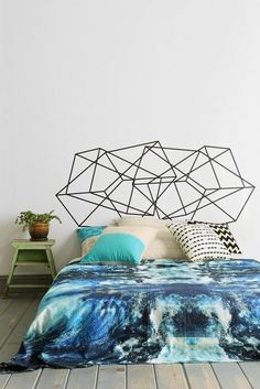 Floor bed and geometric wall art.