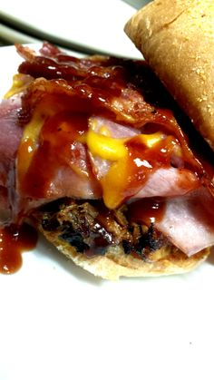 Monday's Special is called The Whole Hog: A smoked pulled pork sandwich with baked ham and crisp bacon topped with BBQ sauce and cheddar cheese.