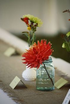 red orange dahlia in mason jar arrangement fom Wedding Flower Inspiration: Dahlias
