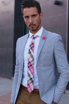 floral blazer, white shirt, pink tartan tie, pink lapel flower, tan leather belt, brown skinny chinos