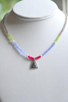 Tanzanite Peridot Ruby and Sterling Silver Buddha by Tarinee, $75.00
