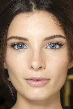 Autumn / Winter 2014 Dolce & Gabbana / Classic beauty at Dolce & Gabbana, with long lashes, flicked eyeliner and glowing skin.