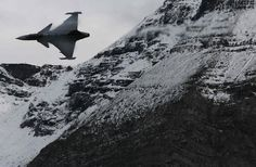 A Swedish Saab Gripen fighter jet performs during a flight demonstration of the Swiss Air Force over the Axalp in the Bernese Oberland 10/11/12