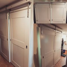 Just finished and installed these overlapping Shaker barn doors with silver hardware. All made by the build team here at Marcotteu0027s. & We just finished and installed this white washed oak barn door with ...