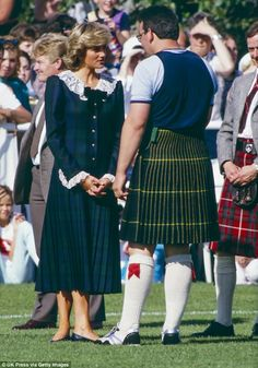 Princess Diana, who was 26 at the time, wore a tartan wool dress by Bellville Sassoon whil...