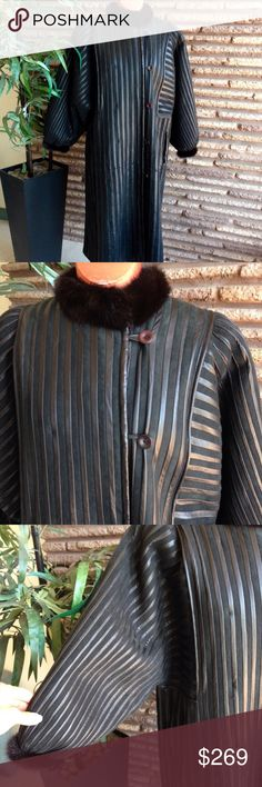 """Vintage 80s Black Leather Faux Fur Coat 1980's vintage long back coat with striped leather panels and faux fur lining. Great Dolman sleeves Cozy and warm Maker: Englunds Päls - made in Finland - known for their fur coats Listed Size: 38  Measurements taken laid flat:  Armpit to Armpit: 24""""  Length: 44""""   Condition: Very good to excellent pre-owned worn, used but not abused condition and coming from a non smoking home. Because of weight , this item must be shipped separately. Vintage Jackets…"""