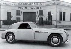 The first roadgoing Maserati, the 1500 with bodywork by Pinin Farina from 1947, in front of the company's head office on the corso Trapani. The styling of the rear of the car and the retractable headlamps are noteworthy. #Berlinetta #Maserati #PininFarina