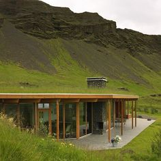 """""""Iceland's vibrant rolling hills provide both shelter and retreat for this blissfully isolated residence by Ask Arkitektar, appropriately named…"""""""