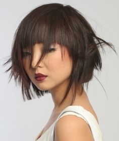 Blunt haircut with long, thinned out pieces.