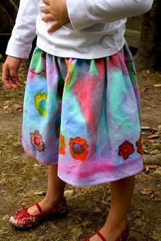 DIY painted flour-sack skirt: Have kids decorate their own clothing with permanent markers and diluted paints! The flour-sack skirt shown here is easy to sew, but I also decorated a pre-sewn onesie right after my niece was born, and it turned out beautifully. Messy but so much fun.