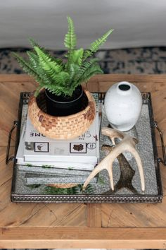 The Basics of Coffee Table Styling - Shades of Blue Interiors Coffee Table Styling, Decorating Coffee Tables, Living Room Candles, Blue Interiors, Small Potted Plants, Square Tray, Metal Vase, Blue Pottery, Round Coffee Table