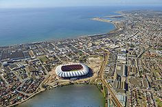 The Nelson Mandela Bay Stadium is a five tier stage, situated in Port Elizabeth, Eastern Cape, South Africa. The construction began in 2007 and an estimated am. Nelson Mandela, Port Elizabeth South Africa, Cities In Africa, Elizabeth City, Shore Excursions, National Parks, Places To Visit, Around The Worlds, Pretoria