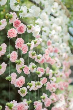 7. Create a Blushing Backdrop - How to Pull Off Blush and Bashful If You're A Modern Day Steel Magnolia - Southernliving. Hanging carnations in various pink hues creates a creative display. You can use this ombre idea as a ceremony backdrop or an accent piece at your reception.  See more on Pinterest.