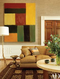 The Obama Family's Stylish Private World Inside the White House | The Family Sitting Room contains a Sean Scully artwork, a Roman Thomas sofa, a Baker floor lamp, and a Jasper side table.