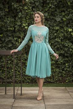 fb7ff4ba6 Vestidos de Cóctel - Nuribel Couture · Vestido turquesa con transparencia  en las mangas y detalles en el top y los hombros.