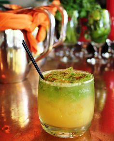 Melones Con Ají: cantaloupe, cucumber water, lime, simple syrup, gin, lime zest, cayenne & paprika garnish