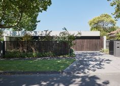 Pleysier Perkins bring an outdated home into a new era of family living in Melbourne's inner east through a muted palette and sophisticated layout updates. Garden Fencing, Garden Pool, German Houses, Pivot Doors, Brick Facade, Level Homes, Australian Homes, Detached House, Cladding