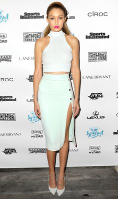 Gigi Hadid in a white crop top, high-slit pencil skirt and pumps