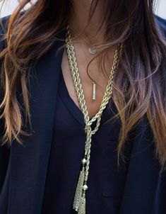 Gold rope-chain tassel lariat necklace...