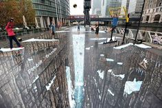 The World's Largest 3D Street Painting: British artist Joe Hill drew the world's largest and longest 3D anamorphic street painting in the Canary Wharf district of London.