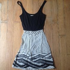 Tribal pattern dress by Silence+Noise Black and white tribal pattern dress with brass geometric studs at waist. Light and airy, still on trend. Worn once for photo shoot. Very, very small hole made in back from bobby pin. Urban Outfitters Dresses