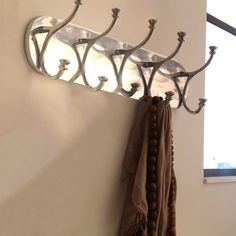 organize your favorite hats coats and scarfs with this aluminum coat rack from urban designs