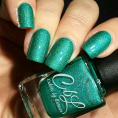 """High School Was Rough Man - A really hard color to describe.  Is it turquoise?  Is it blue?  Is it green?  I would call it all of the former.  This is a polish with that """"glow"""" holo effect that shows a crazy spectrum of glowing colors. Super fun color and bright.  Will dry semi matter.  Use a fast dry top coat to intensify shine and the holo glow.  Let the top coat dry completely and you will be amazed! Swatch by @delishiousnails."""