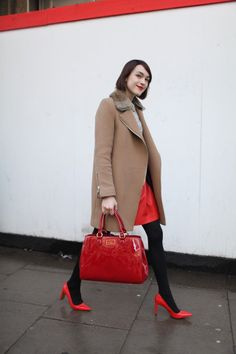 Untamed-Petals-LFW-Fall-2014 Pops of red on this street style walker at London Fashion Week! www.amandajudgeny.com/blog #LFW #fall2014 #cameltrench #red #redheels #redbag #redskirt #streetstyle #fashion