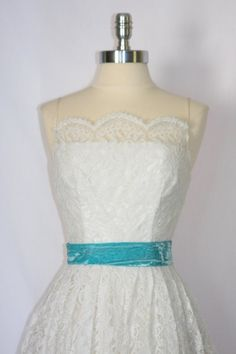 Short Vintage Wedding Dress - 1950's White Chantilly Lace Garden Wedding Frock - XS - Replace belt with purple belt to match perhaps & this fits the bill: lace, sleeveless & an empire waist. It's vintage but the lace is in great condition! $190