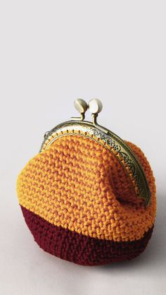 Crochet coin purse, kiss lock coin purse, the Marigold Keeper, in marigold and burgundy