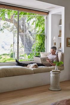 Patina Living & Loving: European Farmhouse Style - Hello Lovely - Patina Living photo of Steve Giannetti with Sophie on built-in window seat bench at Patina Farm. Ph - decorations decor home living room Modern Farmhouse Living Room Decor, Farmhouse Style, Farmhouse Decor, Modern Living, Small Living, Farmhouse Ideas, Farmhouse Windows, Living Spaces, French Kitchen Decor