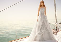 This magnificent textured organza wedding dress with draped bodice, split-front overlay, and asymmetrical skirt is awe-inspiring. White by Vera Wang Style VW351178. #davidsbridal #whitebyverwang #weddingdress