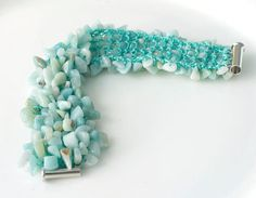 Loving this knitted bracelet with turquoise stone chips